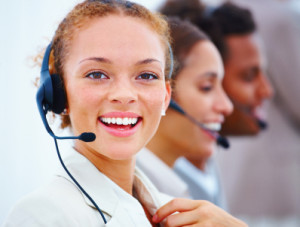 Closeup of a happy pretty executive with headset